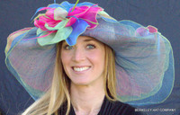 Multicolor Hat, lime crown with blue self-band, three layers of sinamay in fuchsia, lime and blue.