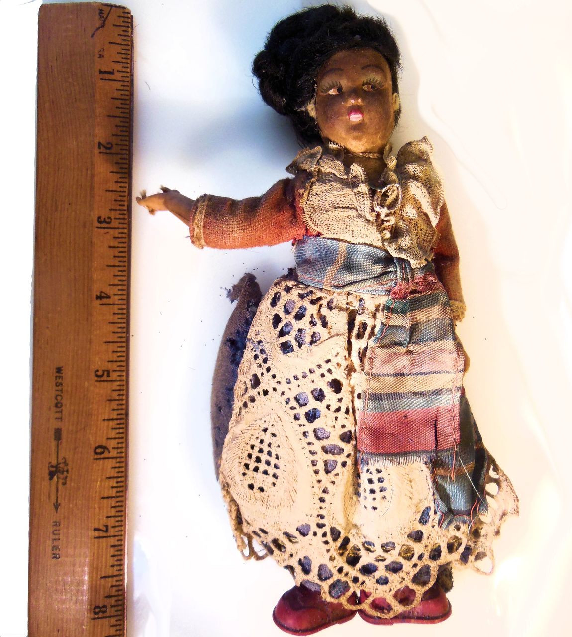 Antique doll who has seen better days.