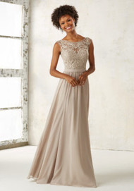 Mori Lee 21522.  Ornate Embroidery and Beading Accentents the Illusion Bodice on This Elegeant Chiffon Bridesmaids Dress. Open V Back with Zipper Closure. Shown in Latte. Available in All Embroidered Chiffon Color Options.