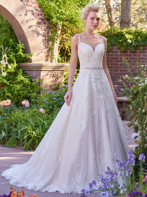 Rebecca Ingram Allison.  This gorgeous ballgown features a layer of lace appliqus over tulle. A V-neckline and open back with lace illusion trim add hints of alluring romance. Accented with Swarovski crystal belt and embellished straps. Finished with covered buttons and zipper closure.  Available in White, Ivory, Ivory over Light Gold, shown.