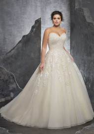 Mori Lee 3238.  Princess Perfect, This Beautiful Tulle Ball Gown Features a Crystallized Beaded Sweetheart Bodice with Embroidered Appliqus. A Corset Style Back Completes the Look. Colors Available: White, Ivory, Ivory/Champagne.