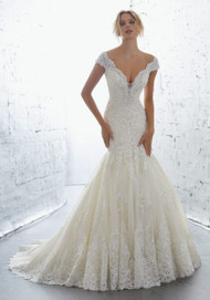"Mori Lee 1701.  Romantic Crystal and Beaded, Alecon Lace Appliqus Accent the Bodice and Skirt on This Net Mermaid Gown. A Scalloped V Neckline and Wide Scalloped Hemline. Complete the Look. Available in Three Lengths: 55"", 58"", 61"". Colors Available: White, Ivory, Ivory/Champagne."
