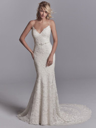 Sottero and Midgley Maxwell. Allover lace motifs drift over tulle and Inessa Jersey in this sexy fit-and-flare wedding dress, accenting the illusion triple-tiered train. Spaghetti straps glide from the V-neckline to crisscross strap details over the plunging back. Complete with attached beaded belt accented in Swarovski crystals. Finished with zipper closure.Available in: Ivory, Ivory over Soft Pearl, shown.