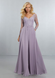 Mori Lee 21561.  Flowing Chiffon, A-Line Gown with Delicately Beaded Embroidery on Mesh Bodice with Long Sleeves with Covered Button Detail at the Wrist. The V-Neckline Flows Around to the Illusion Back with Zipper. View Chiffon Swatch Card for Color Options. Shown in French Lilac.