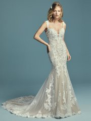 Maggie Sottero Abbie.  This elegant fit-and-flare wedding dress features embroidered lace motifs and crosshatching over tulle. Chic lace straps glide from the illusion plunging sweetheart neckline to the illusion scoop back, all accented in beaded lace motifs. Lined with shapewear for a figure-flattering fit. Finished with covered buttons over zipper closure. Available in: Ivory, Antique Ivory, Ivory over Nude, shown.