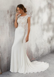 Mori Lee 5688.  Form Fitting Crepe Bridal Gown Featuring an Intricately Beaded Bodice Accented in Alenon Lace Appliqus and Cross-Stitch Embroidery. An Open Keyhole Back Trimmed in Covered Buttons Completes the Look. Matching Satin Bodice Lining Included. Available in: Ivory Only. Shown in Ivory.