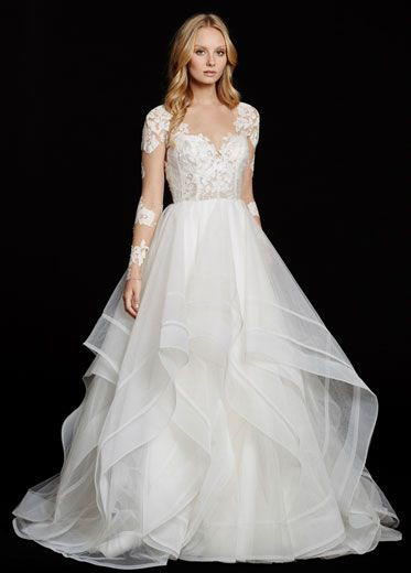 Hayley Paige 6556 Elysia.  Ivory long sleeve lace bridal ball gown, V-front bateau illusion neckline, keyhole back with piping accent, cascading tulle skirt with thin double horsehair edging.
