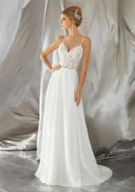 Mori Lee 6861.  Intricate Crystal Beaded Embroidery Meets a Flowing, Soft Chiffon Skirt. Delicate Straps and Corset Style Back Complete the Look. Matching Satin Bodice Lining Included. Colors Available: White, Ivory, and Ivory/Nude.