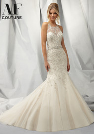 Mori Lee 1301.  Intricately beaded mermaid with embroidered design on net.  Beautiful racerback design and detachable belt.  Available in white, ivory, and light gold.