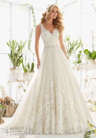 "Mori Lee 2821.  Classic tulle ballgown with beaded, alencon lace appliques and wide scalloped hemline.  Availalbe in white, ivory, and ivory/light gold.  Available in three lengths, 55"", 58"", and 61""."