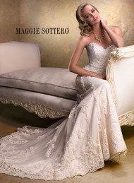 Maggie Sottero Emma.  Slim A-line featuring a delicate, sweetheart neckline and gorgeous beaded motifs.  Available with zipper back or corset back closure.  Detachable cap sleeves offered separately.  Available in white, ivory, and light gold.