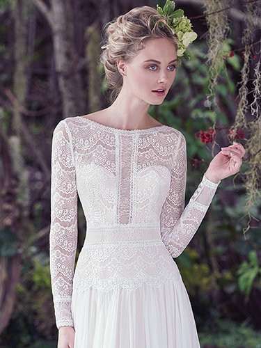 Maggie Sottero Deirdre.  Understated elegance is found in this subtle lace and Santorini chiffon A-line wedding dress, complete with bateau neckline and long sleeves. Illusion lace details and stunning V-back create a sweet-yet-sexy style. Finished with zipper closure. Available in All Ivory, and Ivory over Light Gold.