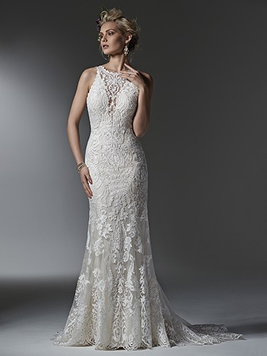 Sottero and Midgley Winifred.  Timeless and elegant, this lace sheath wedding dress features a modern illusion deep V halter neckline, a stunning, scalloped plunging back, and illusion straps. Finished with covered buttons over zipper closure. Available in All White, All Ivory and Ivory over Light Gold.