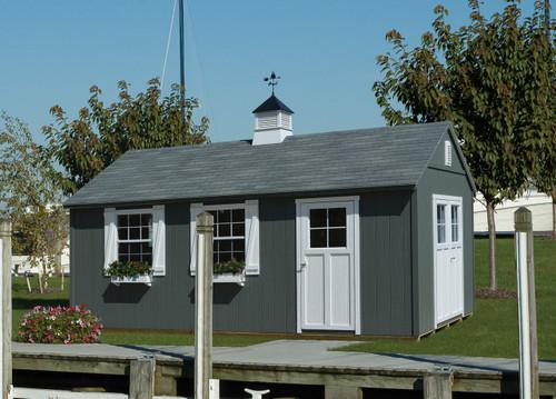 "12x20 Hanover with Night Owl siding, Soft White trim, Medium Gray shingles, Cottage Stall doors, 30""x36"" aluminum windows, Z-style shutters, wood vent, cedar flower boxes, large cupola & sailboat weathervane."