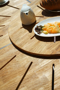 MEIKA Round Dining Table's Central Rotating Insert (detail) - Stainless Steel (hairline finish), Recycled Teak (brushed finish)