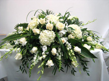 Shades of White Casket Spray