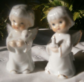 Two glazed china cherubs with gold high lights
