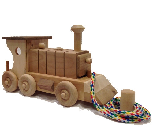 """What makes our engine special? It is built of first quality cherry and birch, in fact it has a solid cherry boiler. A little engineer sits in the cab, and the brightly colored cord lets it run on kid power! The engine is 12"""" long x 4"""" wide."""