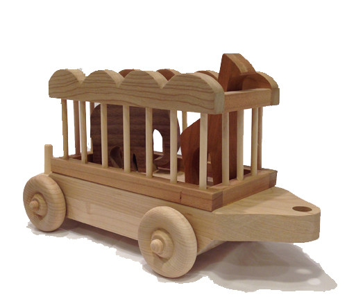 "The maple and cherry circus car carries an elephant and giraffe made of cherry and walnut and is a young child's delight. This is a best seller with grandparents, who remember their own fascination with circus trains. The circus car is 12"" long x 4"" wide. The elephant is 4"" wide and 3"" high. The giraffe is 2"" wide and 5"" high."