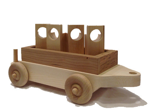 "The flat car carries four wooden cargo designed to be easily captured and lifted by the crane and is designed to follow our Crane Car down the line. The flat car is 12"" long x 4"" wide."