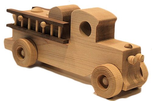 """This timeless treasure is perfect for little hands to push on the floor or table, but to our surprise we sell as many to real fire fighters too, who appreciate the workmanship. The fire truck includes two ladders and a fireman, and is 11"""" long x 4"""" high x 2"""" wide. It is hand crafted in maple with contrasting walnut ladders."""