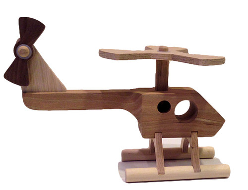 "Not all our toys are for fans of yesterday. Our twenty-first century helicopter has a sleek, modern design, with a functioning whirling rotor blade and spinning tail rotor. Crafted out of cherry, maple, walnut and oak. The helicopter is 7"" long x 2"" wide x 5"" high."