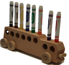"Our school bus cleverly holds eight markers upside down, so they won't dry out or be misplaced. The bus is 11"" long x 3"" high x 2"" wide and sits nicely on a desk. We craft it in maple or oak and give you the markers, too. The school bus is a popular gift for bus drivers, teachers, and college students, as well as the younger set."