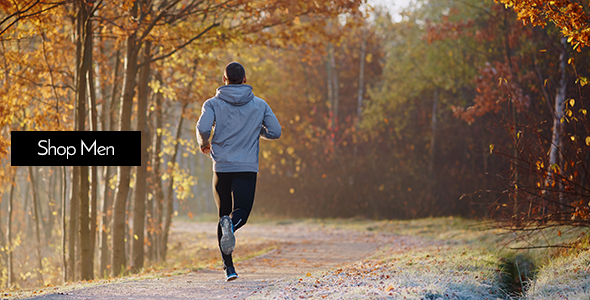 Man jogging down road during fall