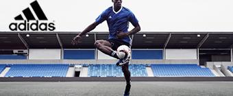 Man playing soccer wearing Adidas