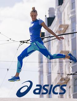 Woman jumping wearing Asics