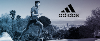 Man running wearing Adidas apparel and running sneakers