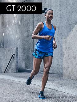 Woman running wearing Asics
