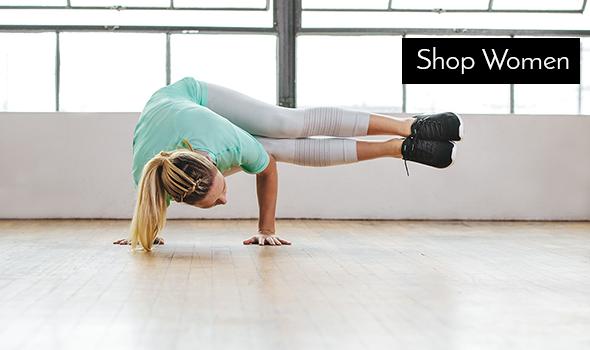 Woman doing yoga wearing Asics