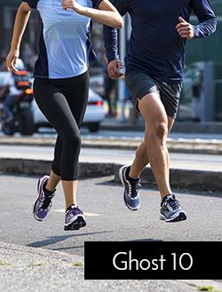 Man and woman running wearing Brooks