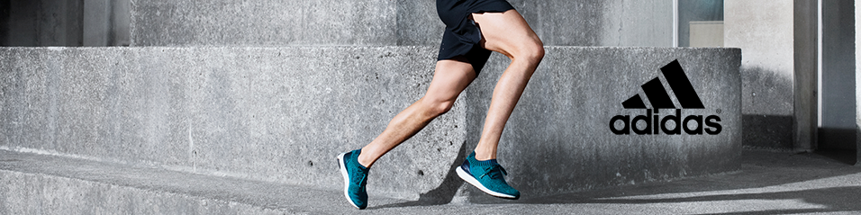Man running outdoors wearing adidas shoes