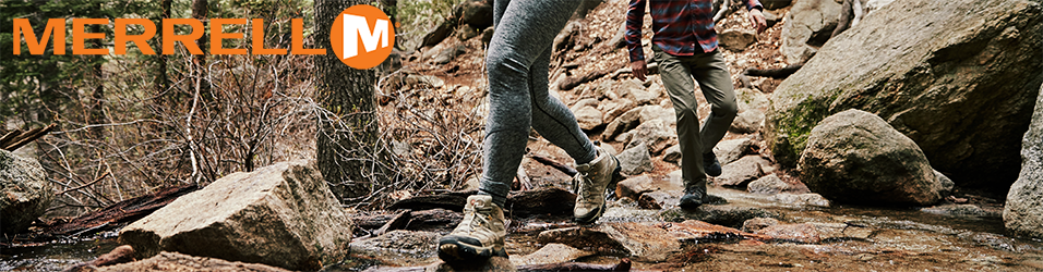 Two people hiking and walking on rocks wearing Merrell