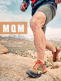 Man and woman walking on mountainside wearing Merrell