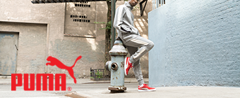Man leaning on fire hydrant wearing Puma