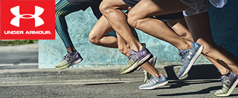 Closeup of people's legs running on pavement wearing Under Armour sneakers