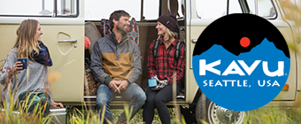 Young people sitting on the side of a van in nature wearing Kavu gear.