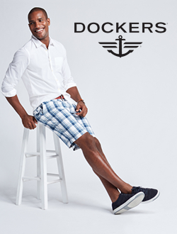 Man leaning on stool wearing dockers attire.