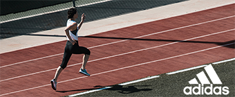 Woman running on a track wearing adidas attire