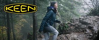 Woman walking in woods wearing Keen
