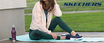 Woman sitting on a yoga mat wearing Skechers