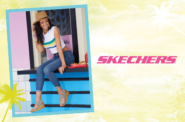 Woman sitting down wearing Skechers