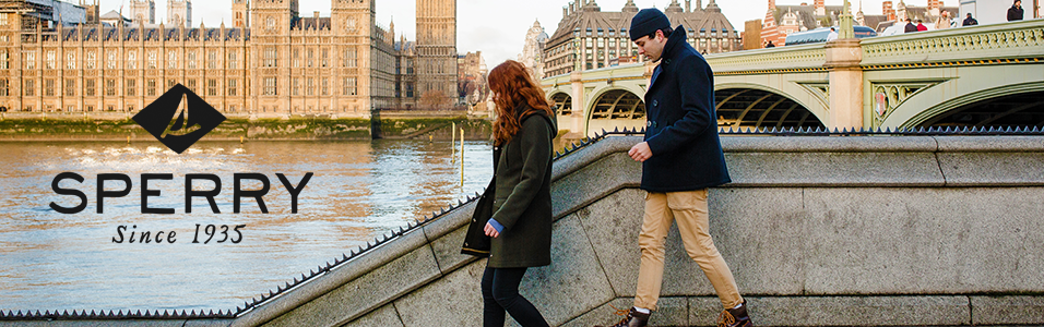 Couple walking outside British Parliament in Autumn wearing Sperry attire and shoes.