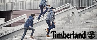 Men running up steps wearing Timberland