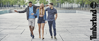 Two guys and a girl walking wearing Timberland