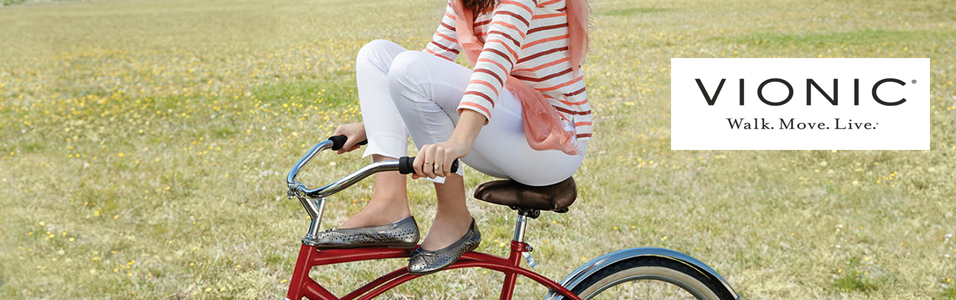 Woman sitting on bicycle wearing Vionic sandals