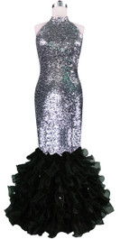 Long dress in metallic silver sequin spangles fabric with black organza ruffles and Chinese Collar front view